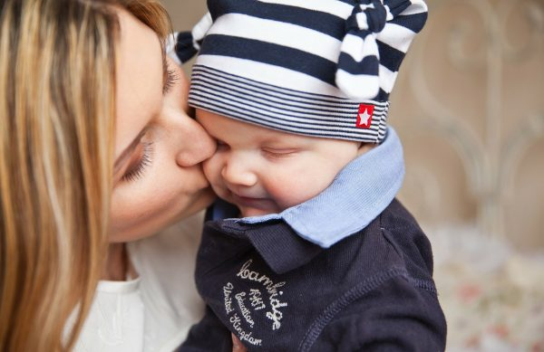 Mother kissing a child