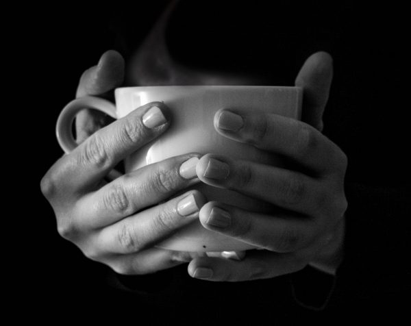 hands are holding cup of coffee