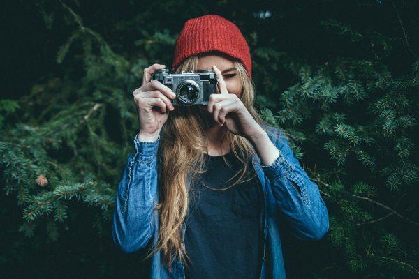 Cute girl taking photo