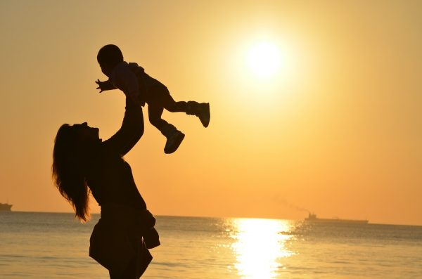 mother and a child in sunset
